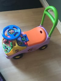 Toddler's pink and green ride on toy car