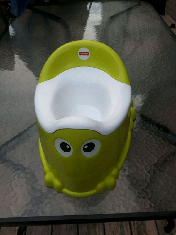 yellow and white Fisher-Price potty trainer