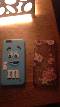 two blue and floral iPhone cases
