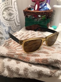 gold-colored framed sunglasses 414 mi