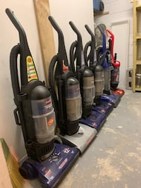 Black and blue upright vacuum cleaners