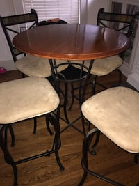 round brown wooden table with chairs Oklahoma City, 73106