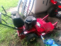 red and black riding mower Forest, 24551