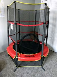 red and black trampoline with enclosure 334 mi
