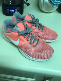 Pair of pink-and-grey  running shoes Greenville, 29607