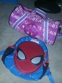 Spider-man themed backpack; pink and purple duffel bag