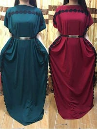 two women's blue and green scoop-neck short sleeve bat-wing long dress