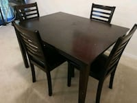 rectangular brown wooden table with four chairs di Whitby, L1R 0J9
