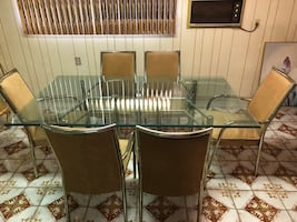 Glass top dining table for six
