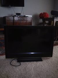 black flat screen TV with remote Loveland, 80538