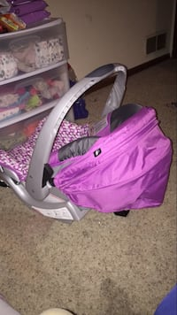baby's pink and white car seat carrier Liberty, 64068