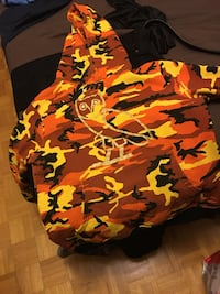 orange and yellow camouflage pullover hoodie