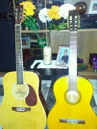 yellow and black classical guitar 542 km