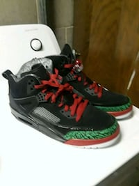 pair of black-green-and-white spizike shoes