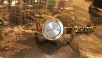 Round silver analog watch with brown leather strap Coral Springs, 33071