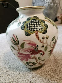 white, green, and red floral ceramic vase 30 km