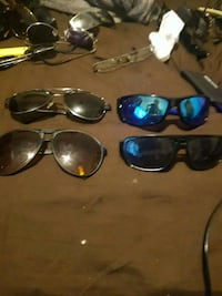 Four pairs of none sunglasses Windsor