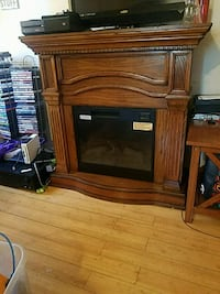 brown wooden TV stand fire place Oakland, 94613