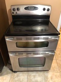 Electric stove with double oven.