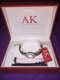 Silver floral analog anne klein watch with two leather strap in box Towson