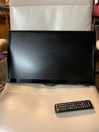 """21"""" flat screen TV with Wall mount and remote"""