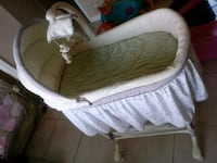 baby's white and pink bouncer