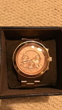 Round Rose gold michael kors chronograph watch with link bracelet