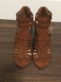 pair of brown leather gladiator sandals Vancouver, V5P 2C7