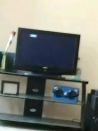 black flat screen TV with brown wooden TV stand Kansas City, 64134