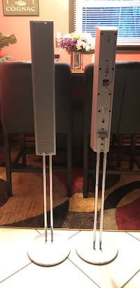 two gray tower speakers