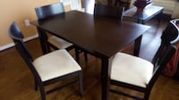 "Dining table and 4 chairs. 4 ft x 30"" x 30"". Very good condition. Barely used. Dark brown, chocolate"