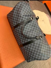 LV Louis Vuitton Duffle bag black with lock and key
