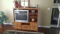gray CRT TV with brown wooden TV hutch Barrie, L4M 5R5
