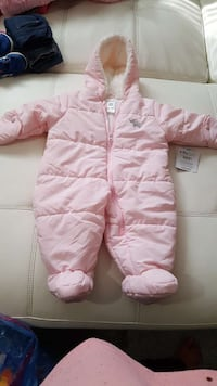 Brand new. 6-9 month snow suit