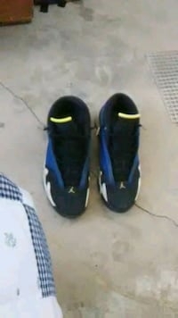 pair of black-and-blue Nike sneakers 1961 mi