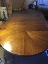 """Good condition wooden table 85"""" in length with both center pieces..has 2 center pieces each piece adds 20"""" without pieces it's 45"""" in length   Ajo and country club area pick up only sorry for the dust in the pic Tucson, 85713"""