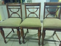 two brown wooden framed gray padded chairs 777 mi
