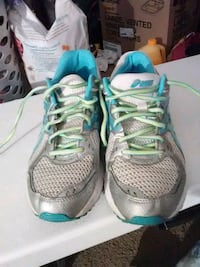 pair of gray-and-teal Nike running shoes