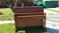 brown wooden upright piano 53 km