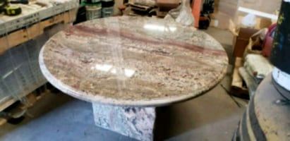 ROUND SOLID GRANITE TABLE.  GREAT FOR HOME OR OFFI