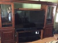 Solid cherrywood entertainment center. Lots of storage and glass shelves on both sides. Beautiful piece of furniture . Warner Robins, 31088