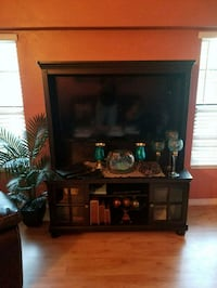 black flat screen TV and brown wooden TV hutch Orlando, 32821