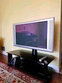 Tempered glass tv stand with 48 inch Philips TV  Toronto, M3K 1W2