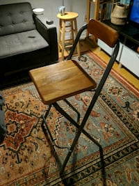 brown wooden folding table with black metal base Toronto, M5A 2P8