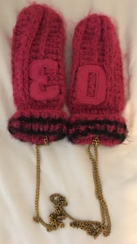 Pair of red knitted gloves