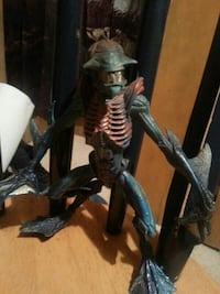 black and brown alien action figure