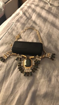 gold-colored and black beaded necklace