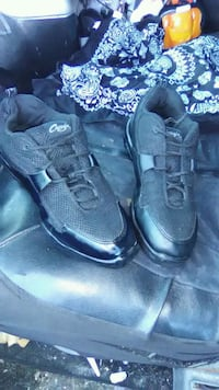 pair of black Nike running shoes Indianola, 50125