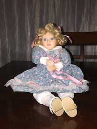 Musical Rotating Seated Collectible Porcelain Doll Zebulon, 27597