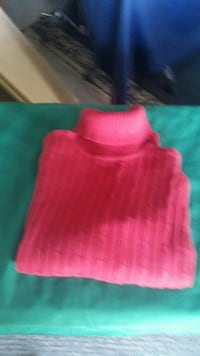 pink turtle-neck sweater